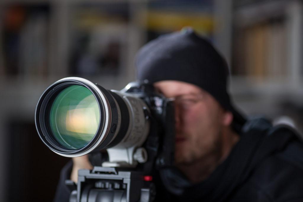 photographe derrière son objectif